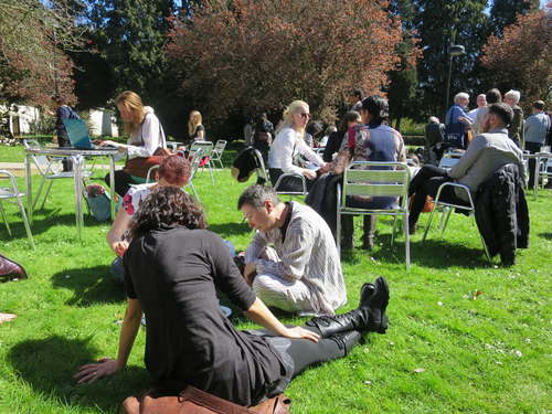 Conversation continues on sunny lawn of Stamford Court, University of Leicester