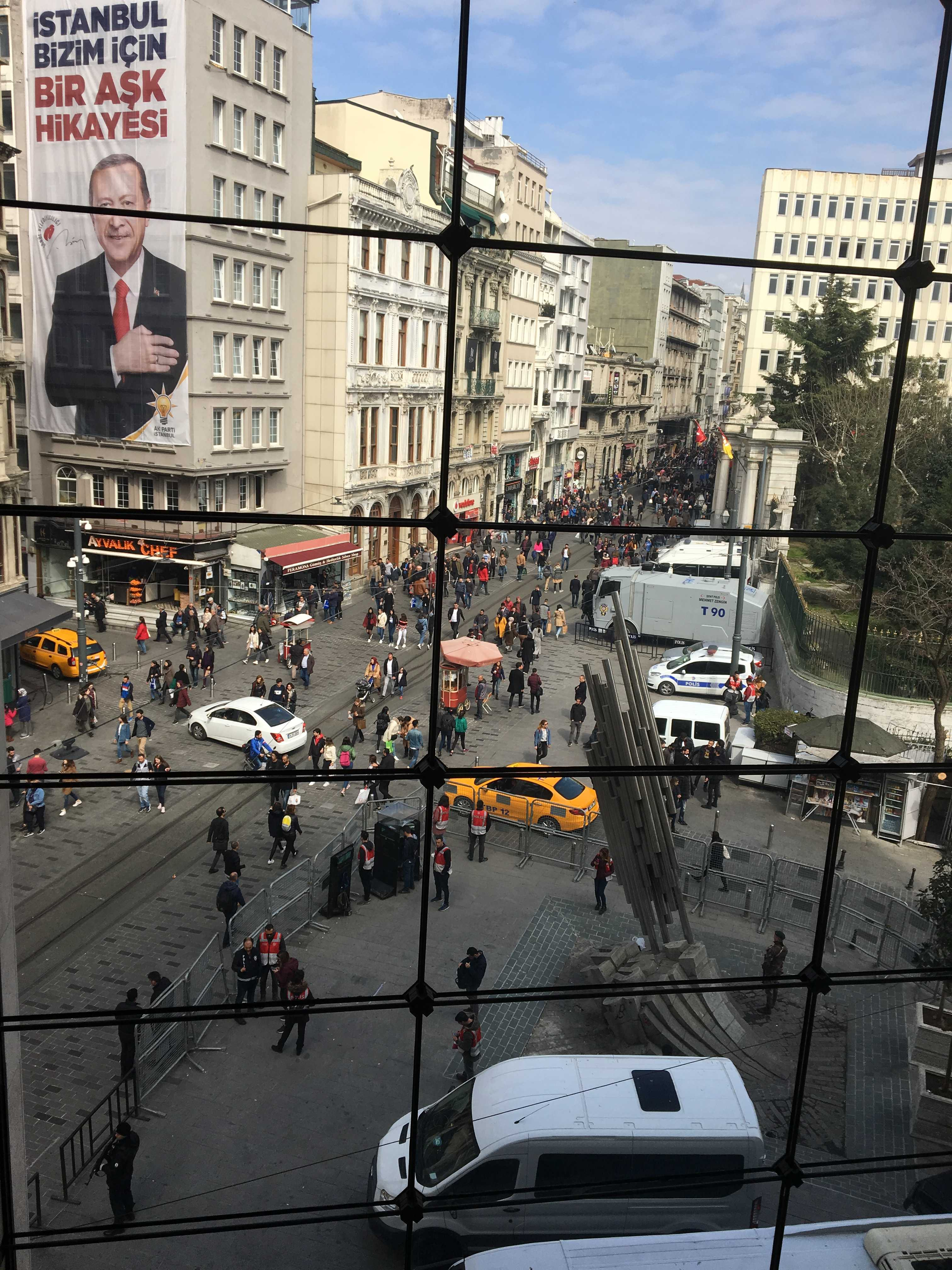 View from the conference venue, fenches and police at the place where the demonstrations took place. On the wall election posters for Erdogan's AK party. photo Annemarie de Wildt